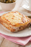 Croque Monsieur. A traditional French toasted cheese and ham sandwich topped with bechamel sauce Royalty Free Stock Photography