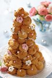 Croquembouche with Pink and White Frosting Roses Stock Image