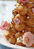 Croquembouche with Pink and White Frosting Roses Royalty Free Stock Images