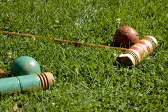 Croquet. Vintage croquet mallets and balls on the lawn Stock Image