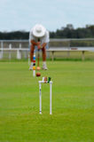 Croquet. Player lining up for a shot Royalty Free Stock Photography