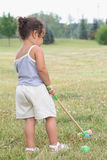 Croquet. Toddler playing a gamer of croquet on a sunny summer day Stock Image