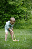 Croquet. A young boy playing croquet Royalty Free Stock Images