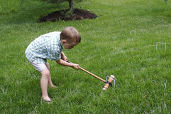 Croquet. A young boy playing croquet Stock Photos