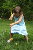 Croquet. A young girl playing croquet Royalty Free Stock Photos