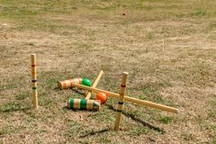 Croquet sports equipment in a field. royalty free stock image