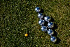 Silveer Croquet Bowling set bowls on a green lawn royalty free stock images