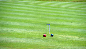 Croquet court. With wicket balls stock photos