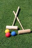 Croquet equipment. Two croquet mallets and three balls Stock Photography