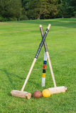 Croquet equipment propped up ready for use Royalty Free Stock Images