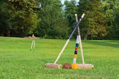 Croquet equipment propped up ready for use Stock Photo