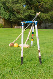 Croquet equipment propped up ready for use Stock Image