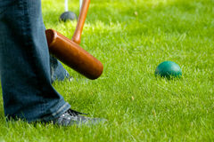Croquet hit 1. Croquet mallet going to hit green ball Royalty Free Stock Image