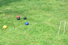Croquet hoop with colored balls Royalty Free Stock Photos