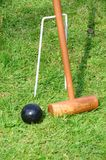 Croquet Mallet and black ball Royalty Free Stock Photos