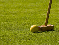 Croquet Mallet and Yellow Ball Stock Photos