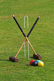 Croquet Mallets Ready for a Game. Croquet mallets, balls and hoops displayed in preparation for a game of croquet Stock Image