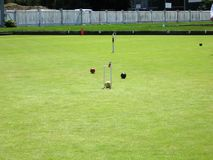 Croquet Playing Field. Three croquet balls in play Royalty Free Stock Images