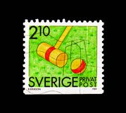 Croquet, Rebate stamps - Summer Activities serie, circa 1989. MOSCOW, RUSSIA - AUGUST 18, 2018: A stamp printed in Sweden shows Croquet, Rebate stamps - Summer stock photos