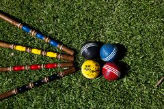 Croquet set and colorfull balls sit on the ground stock photography