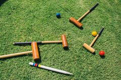A croquet set lies on green grass royalty free stock photos