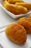 Croquetas and calamares a la romana, spanish croquettes and brea Royalty Free Stock Images