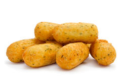 Croquetas de bacalao, spanish codfish croquettes. A pile of croquetas de bacalao, spanish codfish croquettes, on a white background Stock Photography