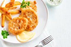 Croquetas de pescados con las patatas fritas Fotos de archivo