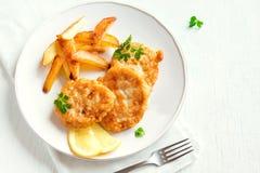 Croquetas de pescados con las patatas fritas Imagenes de archivo