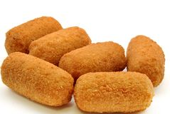 Croquettes. Next to each other surrounded by white background Royalty Free Stock Photography