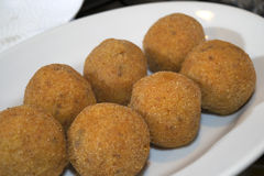 Croquettes and arancini Stock Images