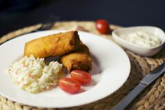 Croquettes and coleslaw Royalty Free Stock Images