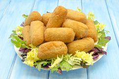 Croquettes. Delicious bechamel croquettes on blue background Royalty Free Stock Photo