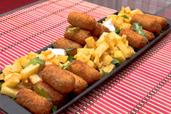 Croquettes and fries Stock Photography