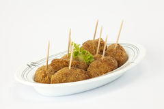Croquettes with salad Stock Photos