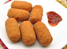 Croquettes with tomato sauce Royalty Free Stock Photos