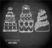 Croquis des gâteaux et des petits gâteaux sur le tableau noir Photo libre de droits