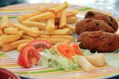 Croquttes frites and salad on plate Royalty Free Stock Photos
