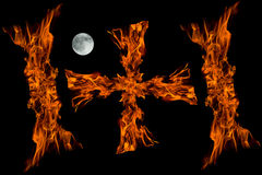 Cros fire flame with full moon,isolated Stock Images