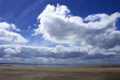 Crosby beach in England. Landscape. Cloudy day and dramatic clouds Stock Photos