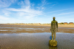 Crosby Beach, near Liverpool with sculptures. Royalty Free Stock Photo