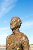 Crosby Beach, near Liverpool with sculptures. Stock Images