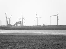 Crosby beach with windmills and industry stock photos