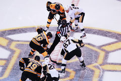 Crosby and Krejci face-off (NHL Hockey). Pittsburgh Penguins forward Sydney Crosby and Boston Bruins  center David Krejci face-off to start the game Stock Photos