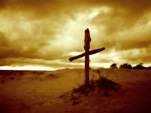 A Cross. Wooden cross in the dune. Artisticaly toned for more express Stock Images
