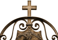 Cross. Old cross made of bronze against a white sky Royalty Free Stock Image