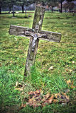 Cross. Jesus nailed to a cross in old graveyard stock photography