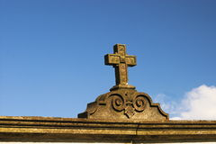 Cross. On the wall Royalty Free Stock Photography