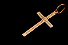 Cross. Gold cross isolated on black Royalty Free Stock Image