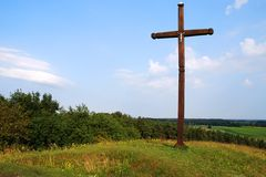 Cross. Wooden Cross and landscape with blue sky background Royalty Free Stock Photography